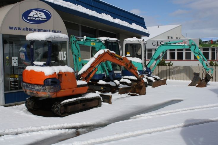 Excavators in snow