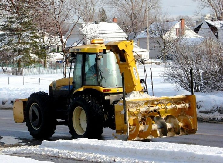 New Holland with Pronovost snow blower