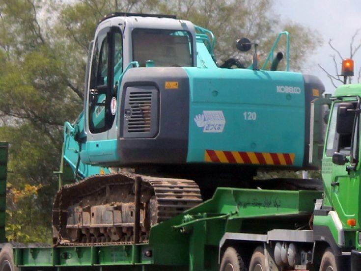 Kobelco excavator on trailer