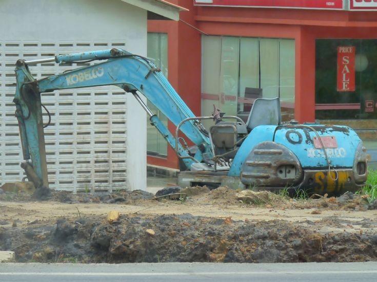 Battered Kobelco excavator